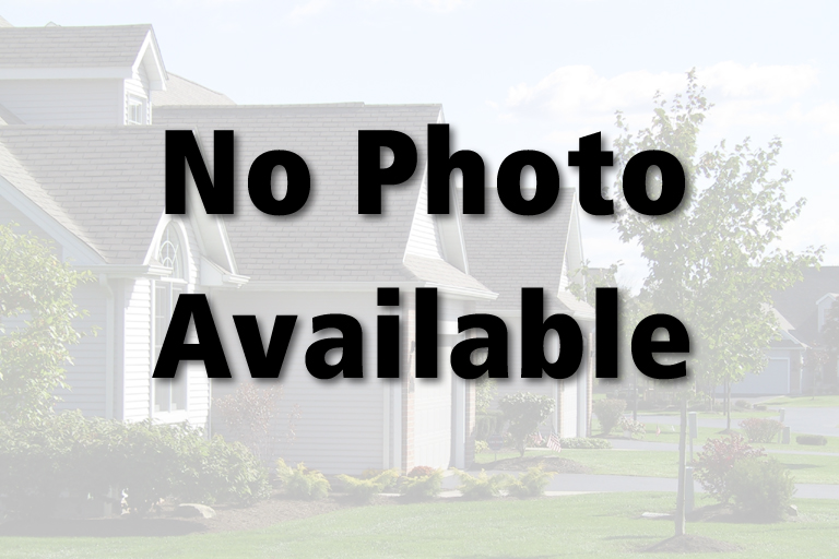 Home offers maintenance free vinyl siding and beautiful landscaping.